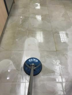 Tile and grout cleaning with hot water solution